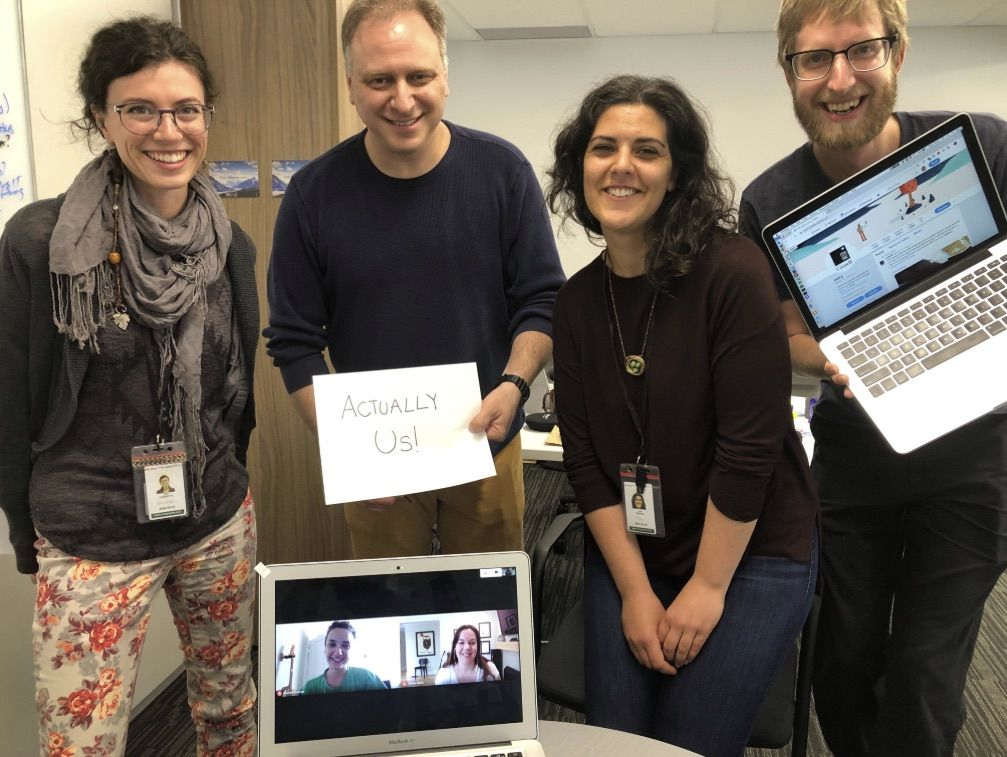 "Photo of team with an ""actually us"" sign before the AMA."